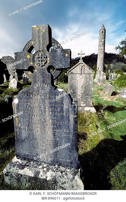 Glendalough, monastery ruins, old gravestone with celtic cross, round tower, County Wicklow, Ireland, Europe