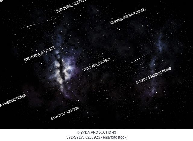 shooting stars and galaxy in space or night sky