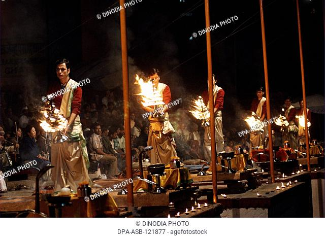 Young priests perform Ganga Aarti at Dasaswamedh Ghat which starts just after sunset at Varanasi ; or banaras ; (also known as Kashi) ; Uttar Pradesh ; India
