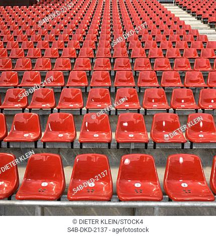 Red chairs in a stadium