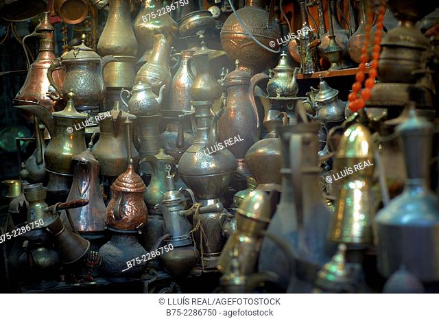 Lots of Arab coffeepots and teapots in an antique shop in Jerusalem, Israel