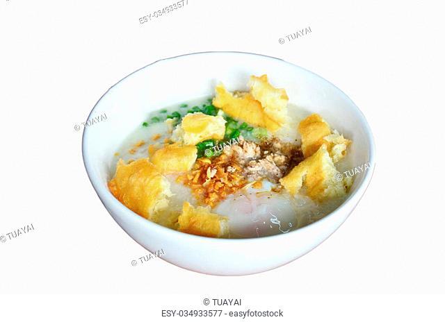 Rice porridge or Congee with white deep-fried doughstick or sugar sponge cake