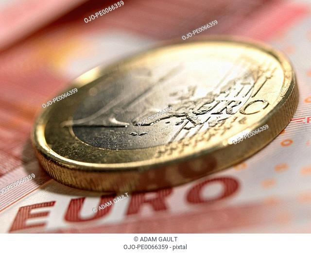 Close up of euro coin and currency
