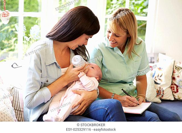 Mother With Baby Meeting With Health Visitor At Home