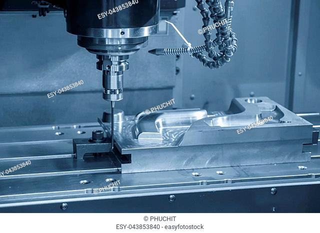 The vertical CNC milling machine attach the CMM probe in the light blue scene. High technology manufacturing process