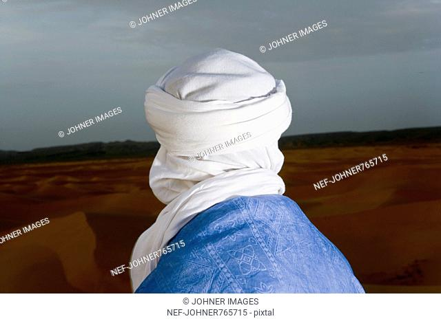 A man in a turban from behind