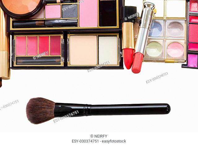 cosmetic products and make-up brush isolated on white background