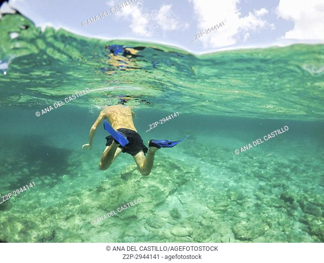 Young man snorkeling in Formentera island Balearics Spain