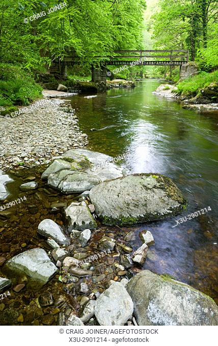 Ash Bridge over the East Lyn River in Barton Wood in Exmoor National Park near Watersmeet, Lynmouth, Devon, England