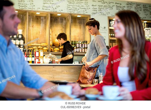 Couple talking in busy cafe