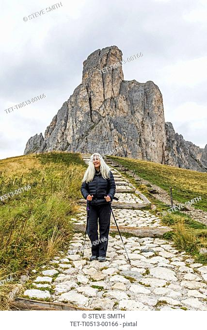 Woman hiking in the Dolomites, South Tyrol, Italy