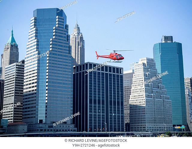 A sightseeing helicopter departs the Downtown Heliport in New York