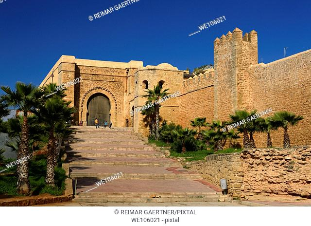Boys playing soccer at Bab Oudaia gate to the Kasbah in Rabat Morocco