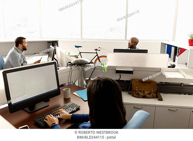People working at computers in office