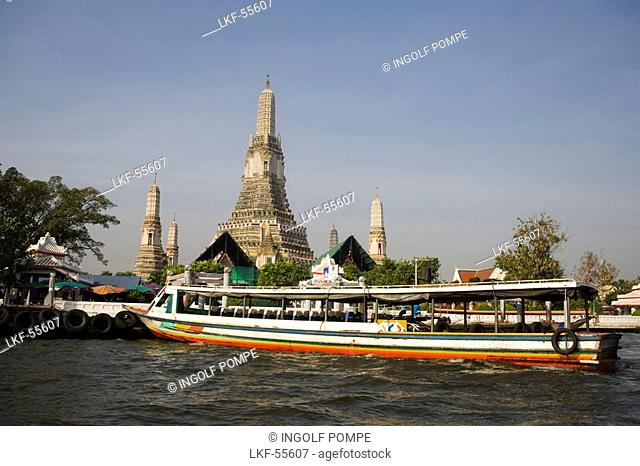 View over the river Menam Chao Phraya with ferry boat to Wat Arun, Temple of Dawn, Bangkok, Thailand