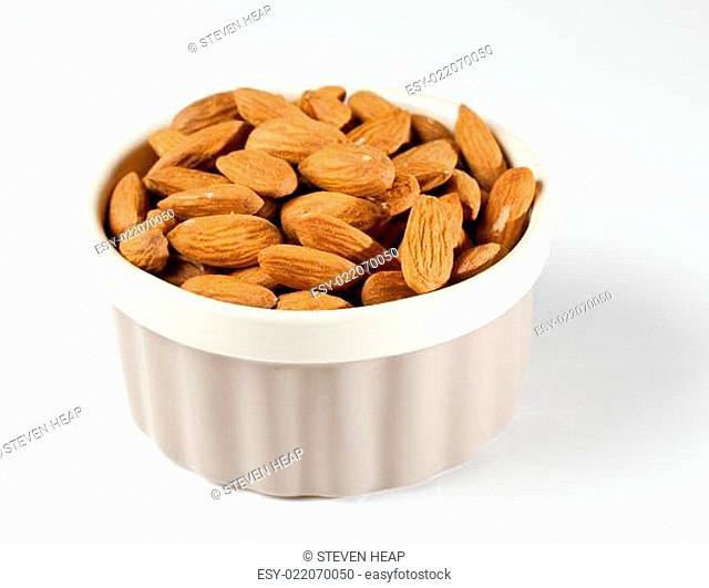 Raw organic almonds in bowl