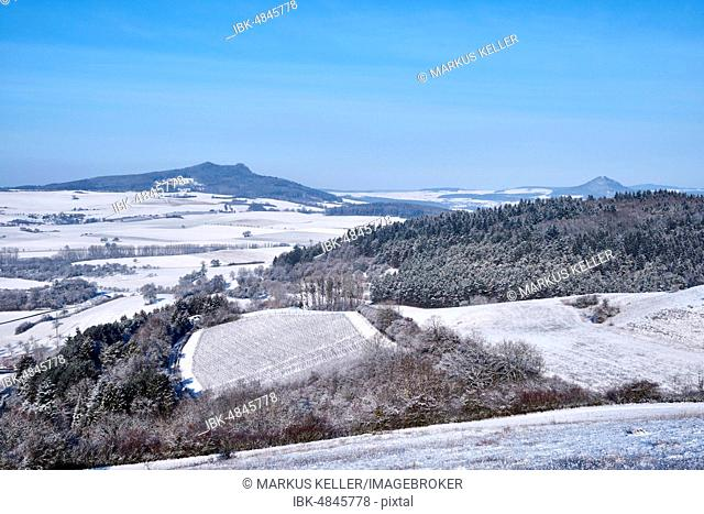 View into the Hegaul landscape, in winter, at the horizon of the Hohenstoffeln and Hohenhewen, Baden-Württemberg, Germany
