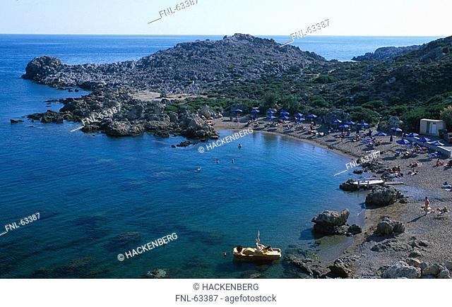 Aerial view of tourists on beach, Faliraki, Greece