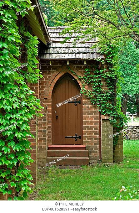 vine covered church building