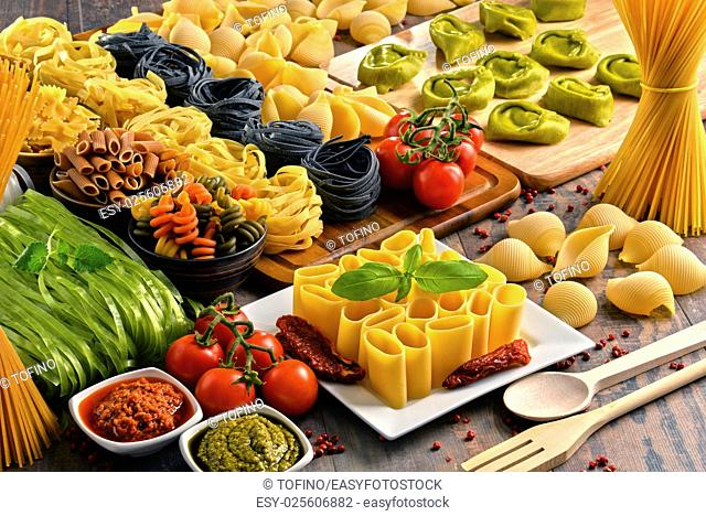 Composition with variety of pasta on kitchen table