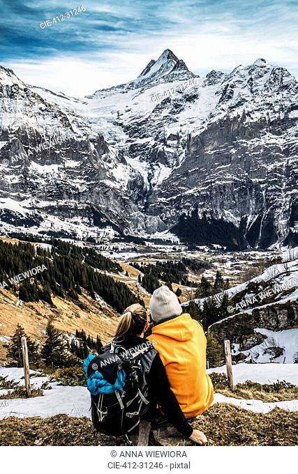 Couple looking at snowy mountain view, Grindelwald, Switzerland