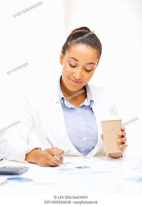 business, office, school and education concept - businesswoman with documents and takeaway coffee