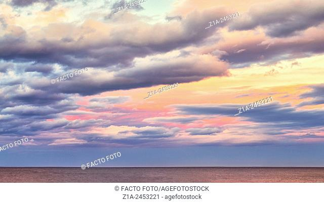 Clouds by sunset at the Mediterranean sea