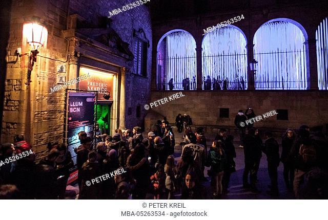 People waiting to enter Light installation, Blue light, Festival patron Saint, urban art, Llum, Barcelona, Catalonia