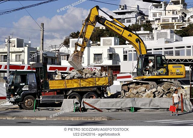 Naha, Okinawa, Japan: a bulldozer destroying an old house to make space to a new one