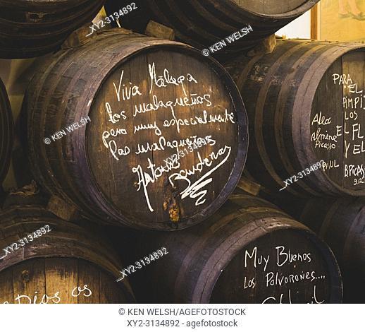 Malaga, Costa del Sol, Malaga Province, Andalusia, southern Spain. Old wine barrel in Bar El Pimpi with inscription and signature by Malaga-born actor Antonio...