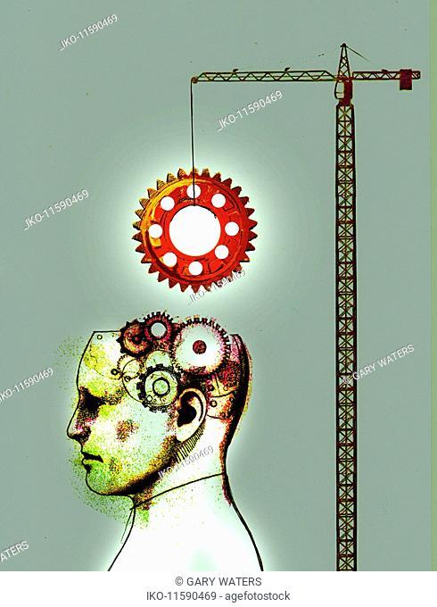 Crane lifting large cog into man's brain