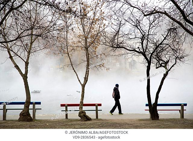 Tourist. City Park at fog. Budapest Hungary, Southeast Europe