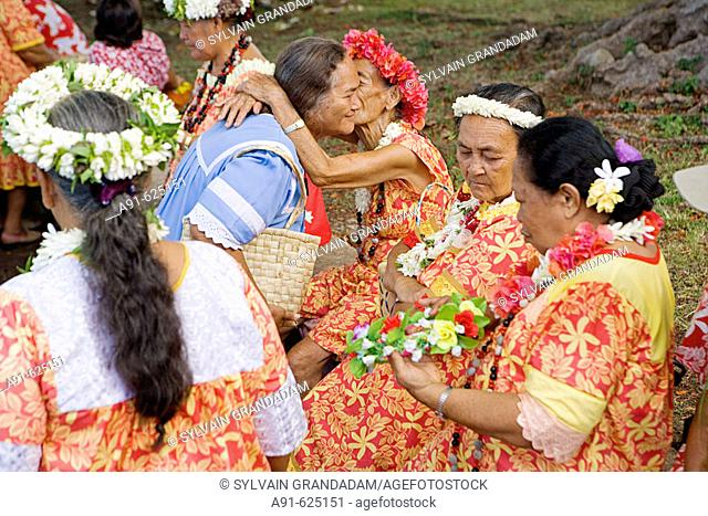 Stopover in Nuku Hiva island, Taihoae (main village of the North islands). The ladies choir greets the tourists. Cruise on Aranui III