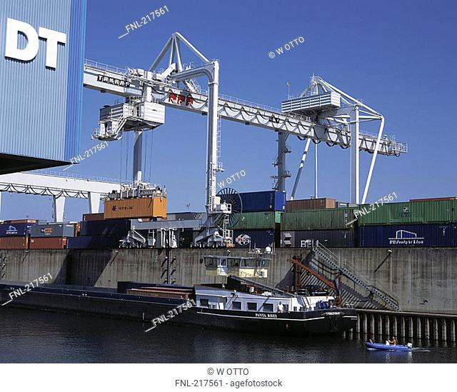 Cargo containers and crane at harbor, Ruhrort, Duisburg, North Rhine-Westphalia, Germany