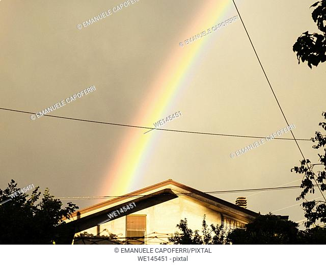 Rainbow over a house