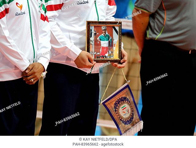 The Team of Iran shows a picture of dead Iranian cyclist Bahman Golbarnezhad prior sitting volleyball Men's Gold Medal Match between Bosnia and Herzegovina and...