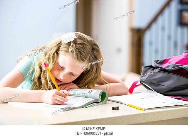 Girl (8-9) doing homework