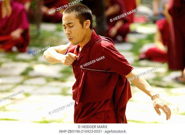 Monks practicing debating at Namgyal Gompa inside the Tsuglagkhang Complex