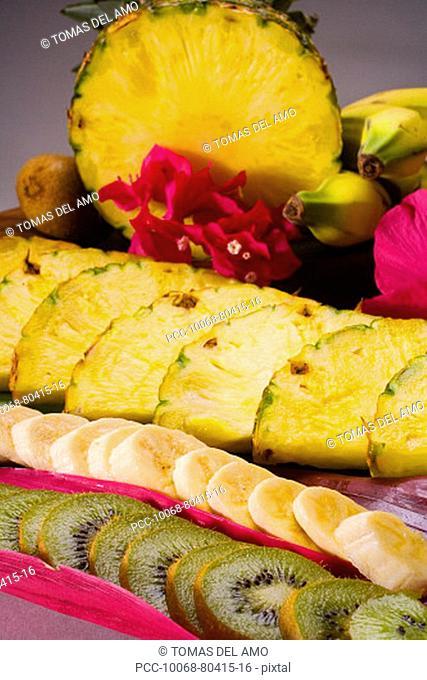 Close-up of kiwi, banana and pineapple slices