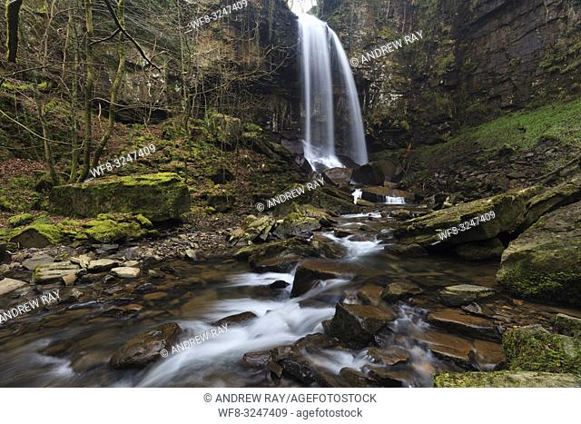 Melincourt Waterfall in the Vale of Neath in South Wales, captured in mid February using a long shutter speed to blur the movement of the water coming over the...