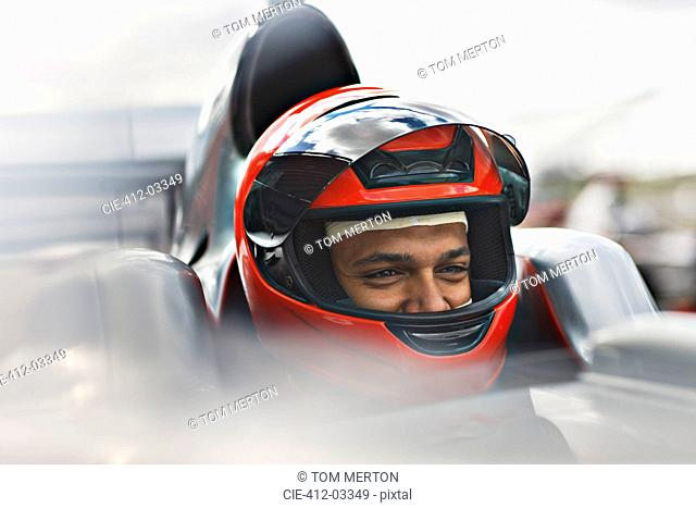 Racer sitting in car on track