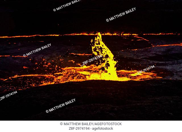 The permanent lava lake of Erta Ale erupts with hot lava