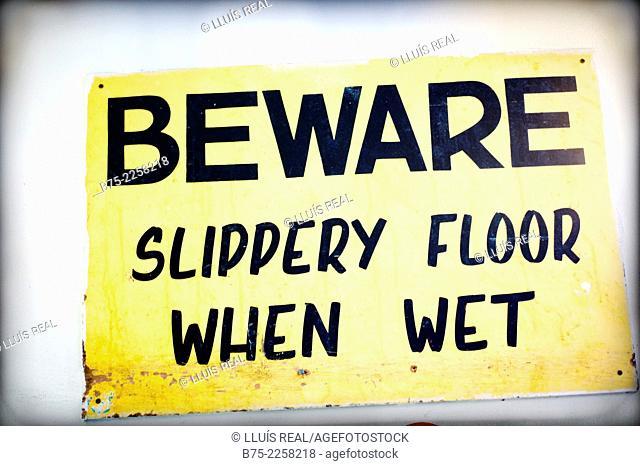 Beware floor slippery when wet. Urban symbolism in London, England, UK, Europe