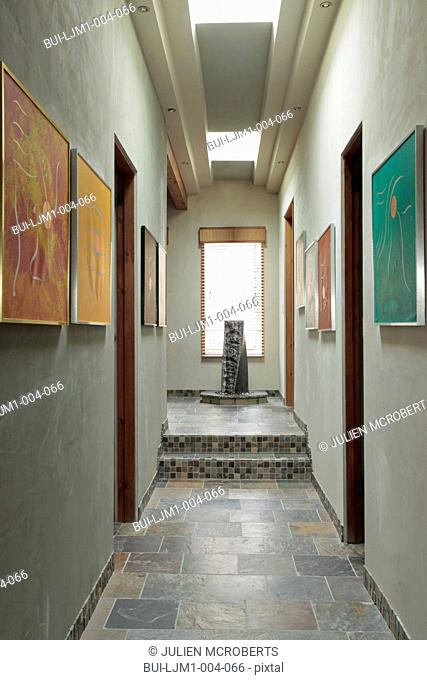 Hallway in eco friendly home with tile floors and skylights