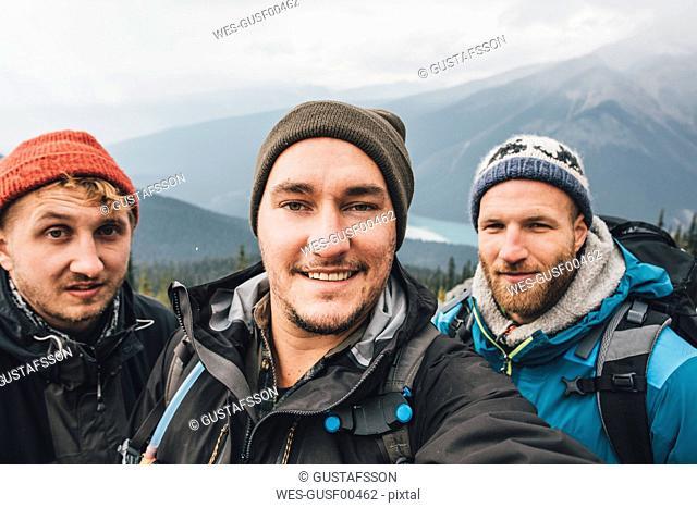 Canada, British Columbia, Yoho National Park, selfie of three smiling hikers at Mount Burgess