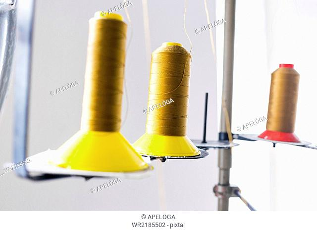 Golden thread spools in jeans factory