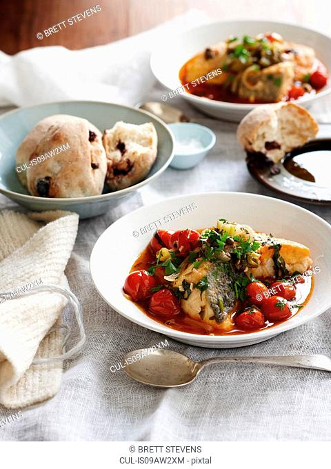 Sicilian monkfish stew and bread rolls