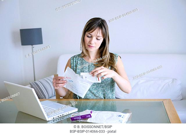 Woman receiving medicines bought on internet