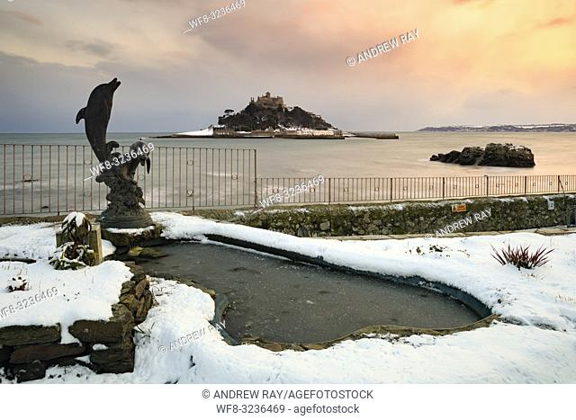 A snow covered park at Marazion in Cornwall, with St Michael's Mount in the distance. The image was captured shortly after sunset in early February