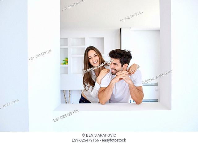 romantic happy young couple relax at modern home staircase indoors